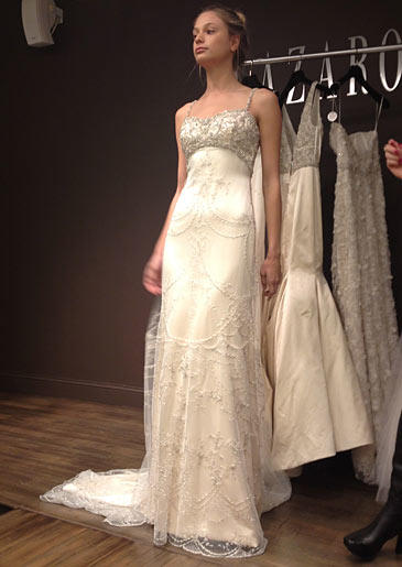 This empire waist Lazaro gown has a beaded bustline and dreamy beaded overlay.