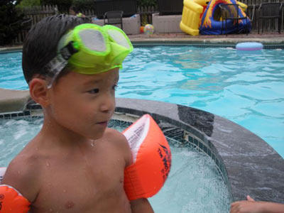 Aaden plays it safe in the pool with floaties and goggles.  Keep practicing!