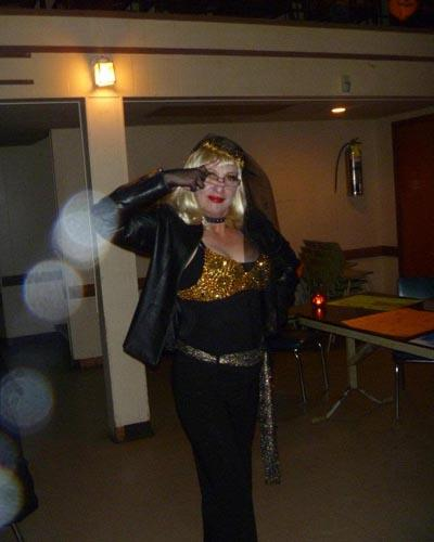 This is me at a Halloween party this past October. Being a huge believer, I was happy to see the visions in this pic! My only sister and sibling passed a few years ago due to MS. My grandmother who was so into psychic abilities and my female soulmate who is in heaven along with other dear family members makes me believe that they are in this photo surrounding me. -- Janice K.