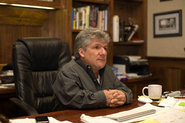 Join us for a look at life on Roloff Farms in Oregon. Here, dad Matt Roloff sits at his desk in the family home. He's got many unique ideas for attracting visitors to the farm, but the best is the pumpkin patch every fall.
