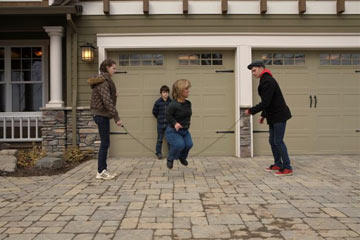 Amy Roloff jumps rope in the driveway with the help of her kids Molly, Jeremy and Jacob.  The family would fall apart without Amy's caring and watchful eye making sure her kids, and especially her husband, are behaving themselves.