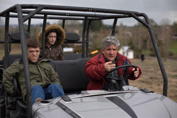 Zach, Molly and Matt ride a golf cart around the family's property in Oregon.