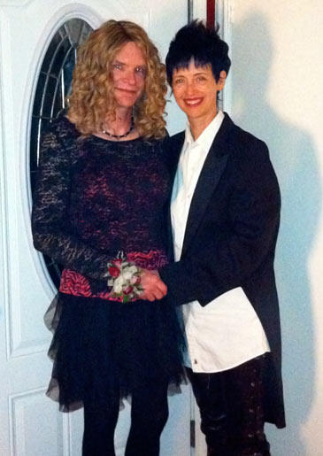 In addition to wearing wigs herself, Tamis also likes to occasionally dress up her boyfriend, Hans. The two pose for a picture.