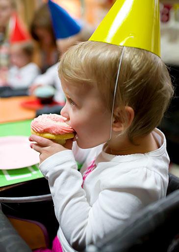 Lila eating some birthday cupcake.
