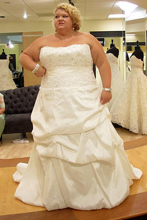 Christy wears 2 Be Bride Style Sabrina.  Fabric: memory taffeta/beaded lace  Description: lace bodice with bubble pickup skirt  Color: white  Price: $$