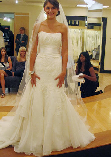 Kaci wears Marisa Style 895.Fabric: silk organza/Alencon laceDescription: lace down one side of bodiceColor: ivoryPrice: $$