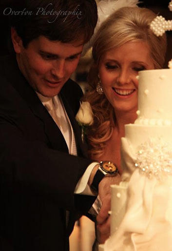 """Holly and Robert cut the bride's cake while """"So This Is Love"""" from Disney's """"Cinderella"""" plays. """"We had to have a princess song in there somewhere,"""" Holly explains. While Robert cut his groom's cake, the DJ played the University of Alabama fight song."""
