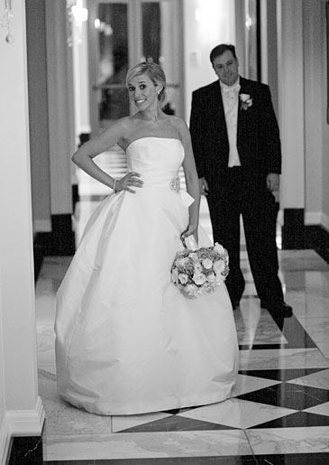 Stephanie's groom, John, admires her dress.