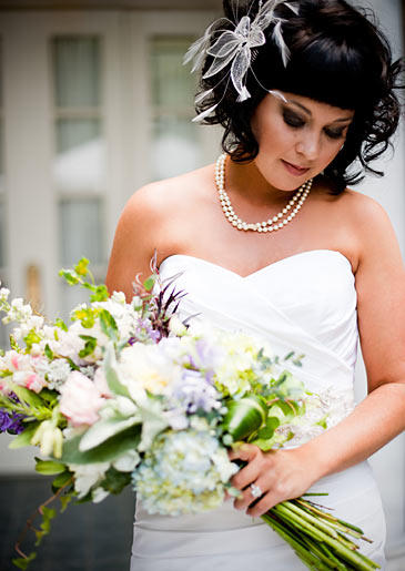 Tracy poses with her bridal bouquet.