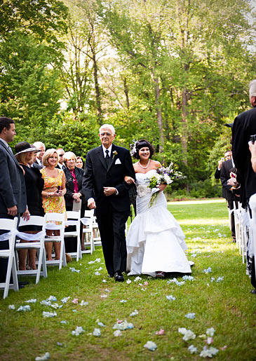 Tracy's grandfather walks her down the aisle on her wedding day.