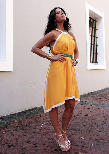 Stacy's look here features a deep yellow that brings out her summer glow. The green belt adds a burst of fun color that pulls together white and yellow, the optimum summer duo.