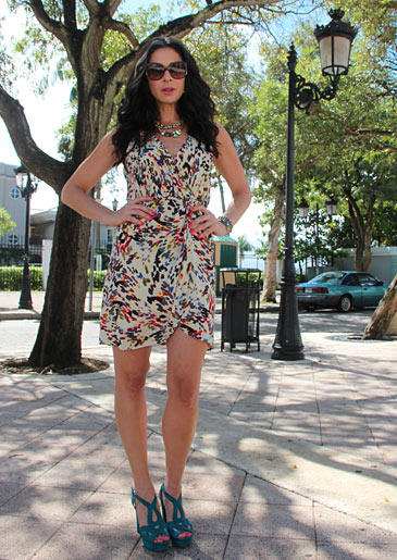 """This wrap dress is fun and flirty with its multitude of vibrant colors. Big sunglasses and brightly colored shoes emphasize the """"summer"""" in this style of Stacy's."""