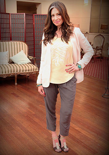 Yellow, even a quieter shade, makes any look pop. Stacy's grey pants and white blazer are accompanied by this fun color for the latest summer look.
