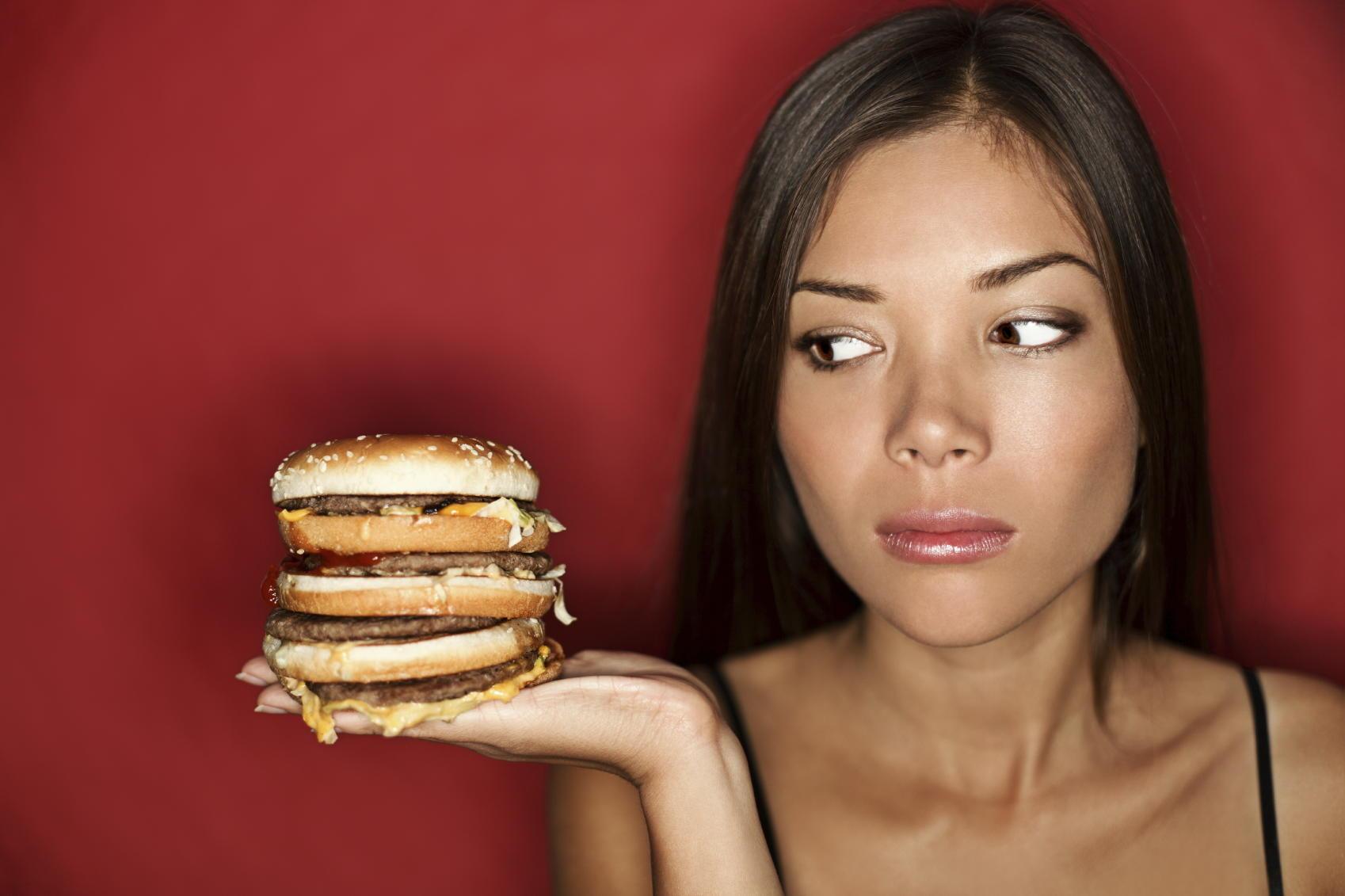 woman looking at cheeseburger