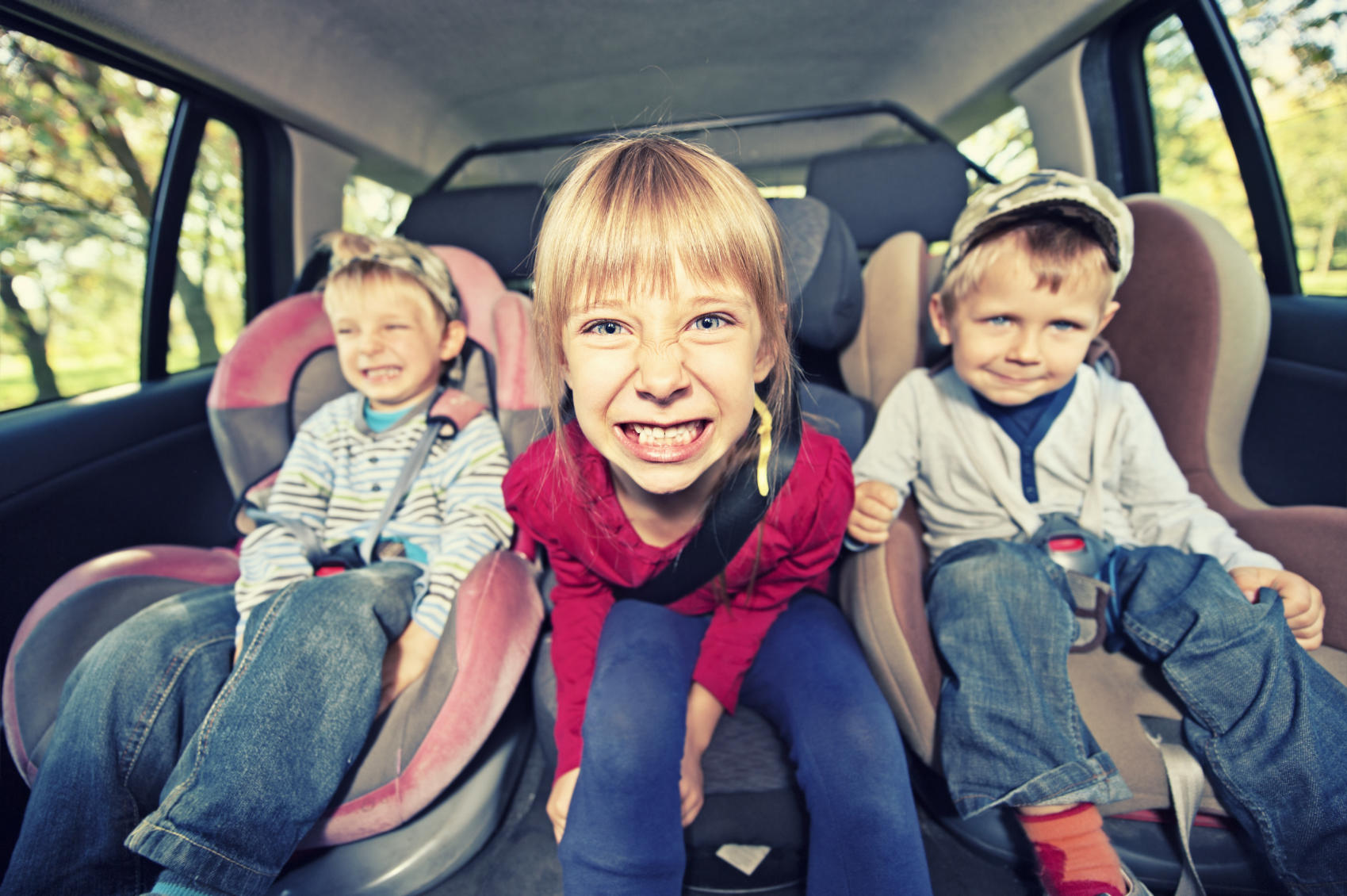 kids in the back seat of a car