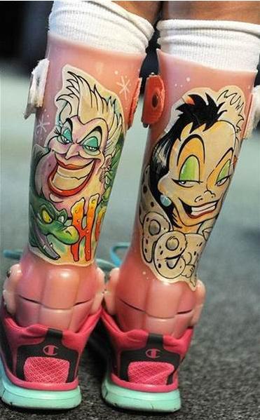 a closeup of a young girl's tattooed leg braces