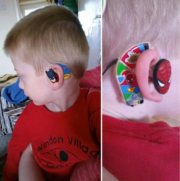 child wearing superhero themed hearing aids