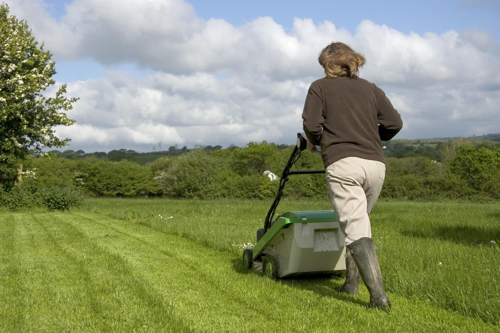 picture of a woman pushing a lawn mower