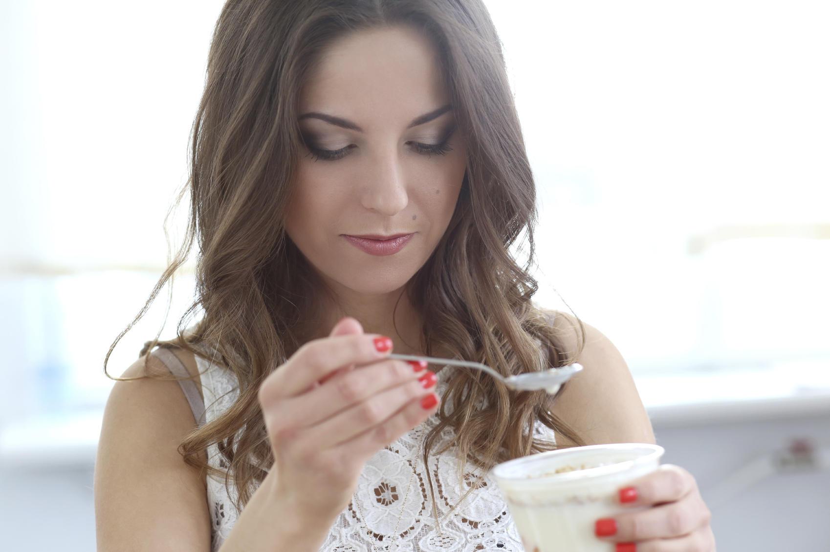 beautiful girl with yogurt
