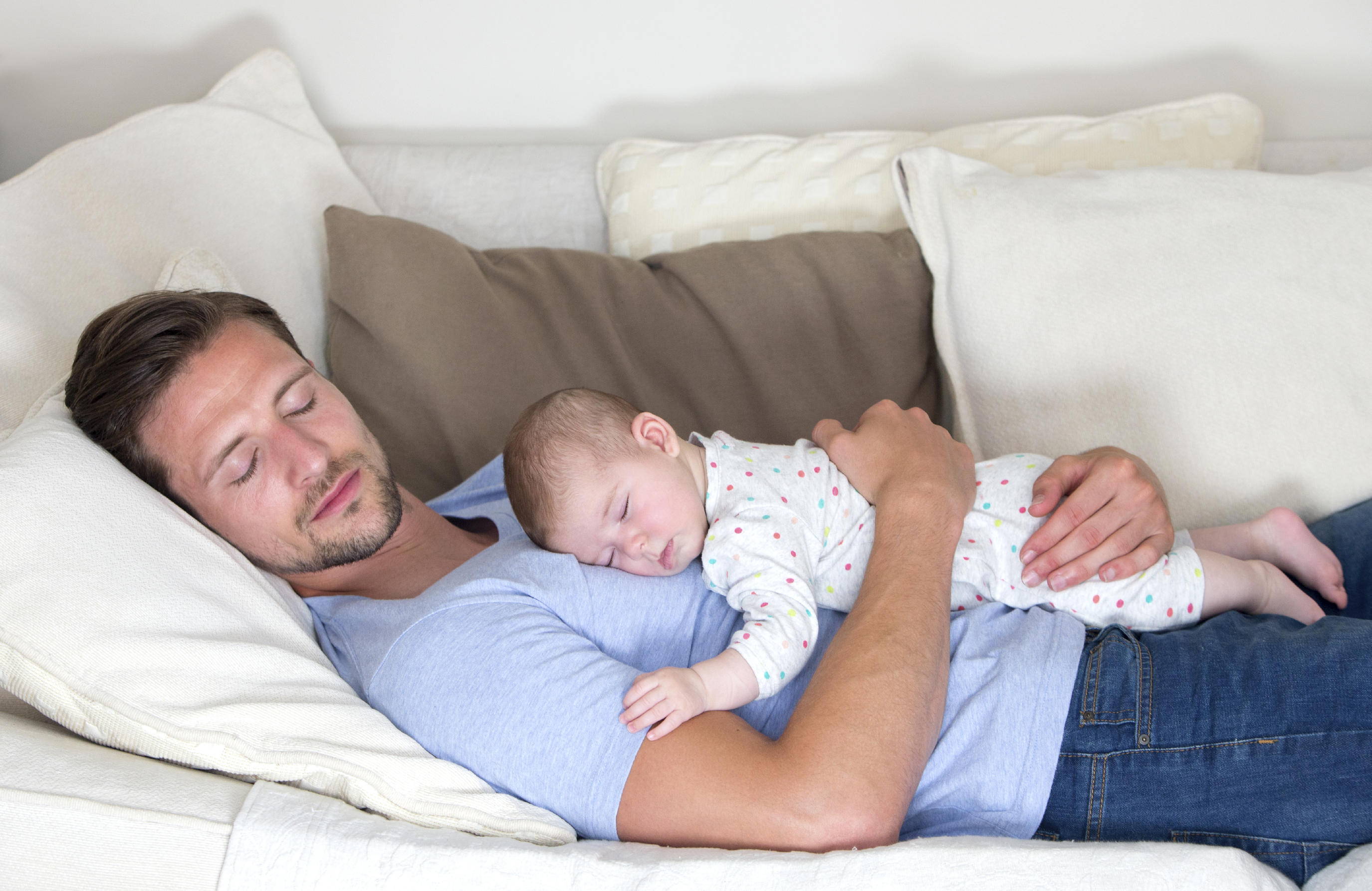 baby asleep on dad's chest