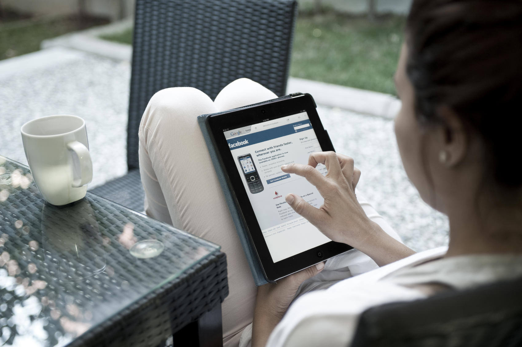 woman with tablet showing facebook