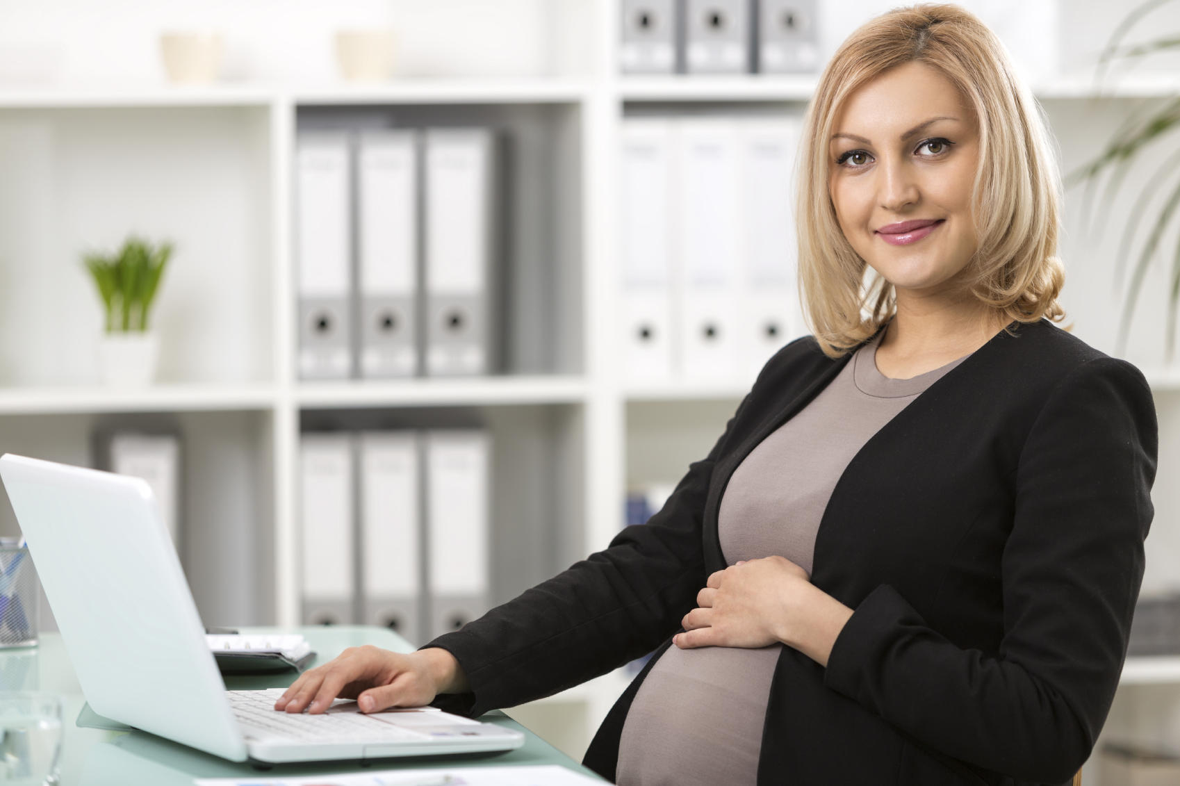 Pregnant businesswoman working on a laptop