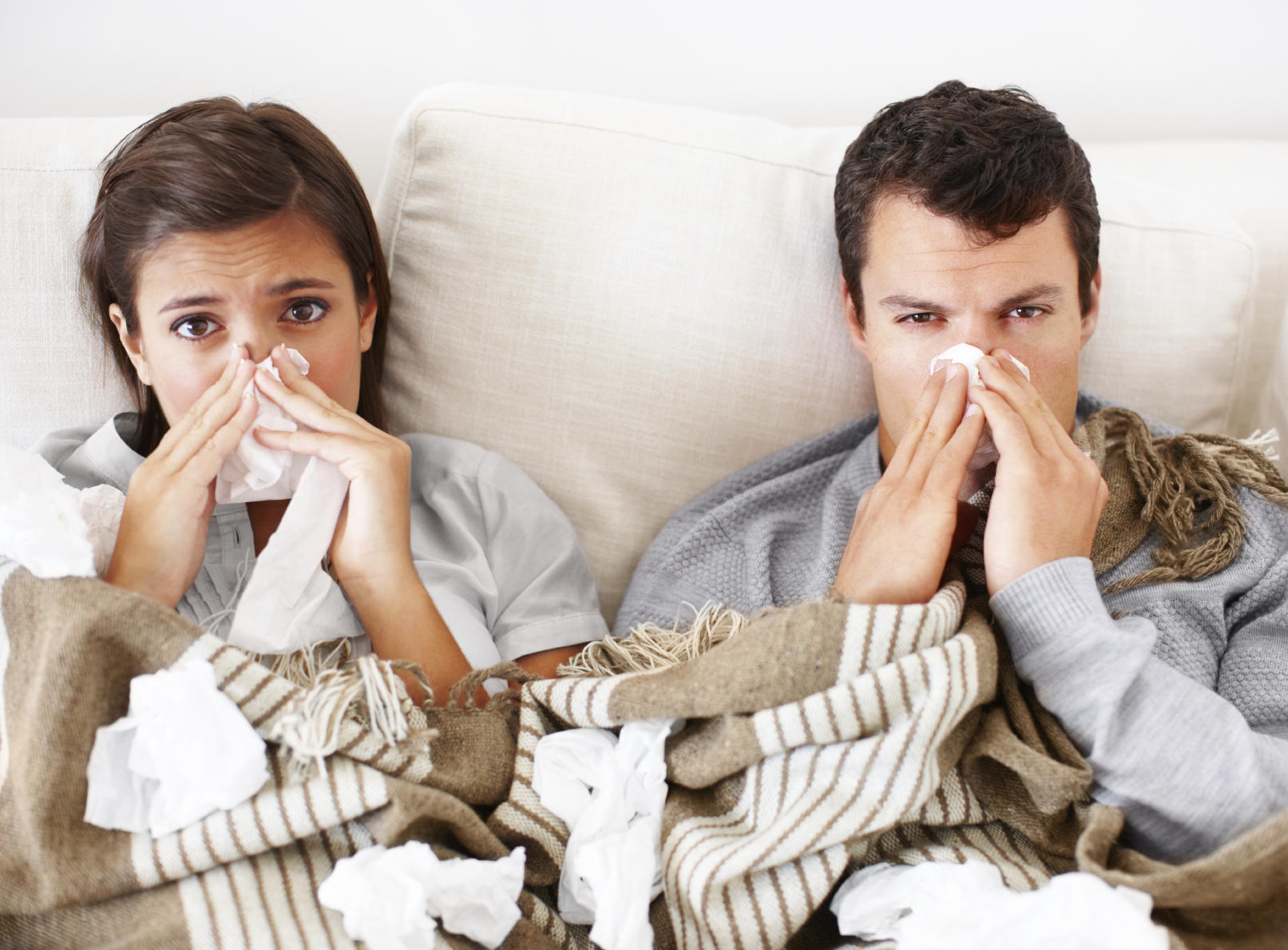 couple in bed with a cold