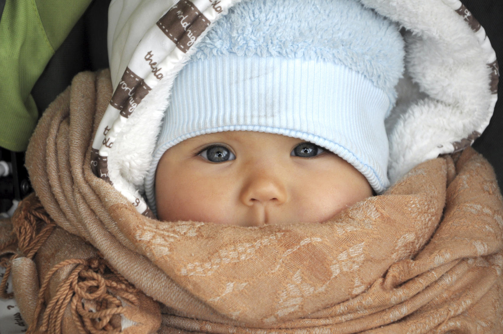 Baby in warm clothes in cold weather