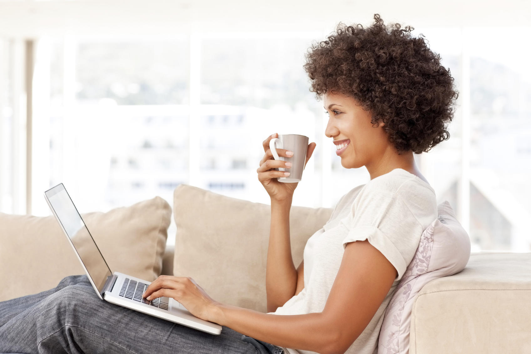 Relaxed Woman Using Laptop