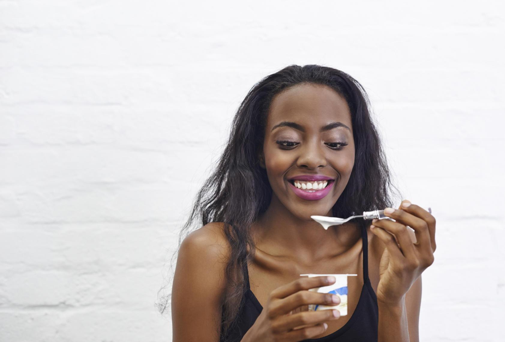woman eating yogurt