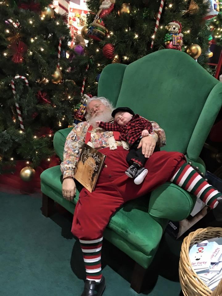 baby sleeping with santa