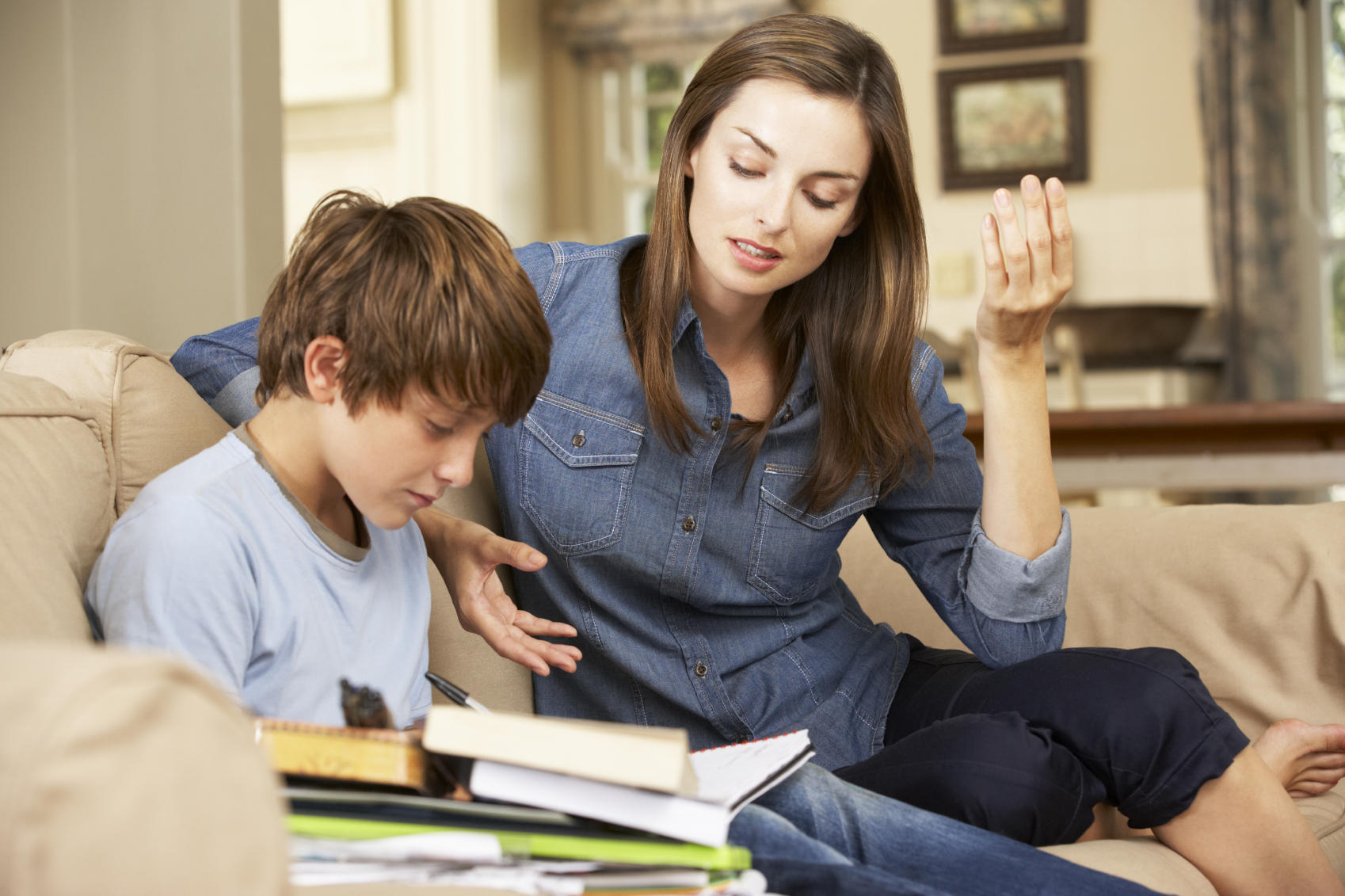 woman with kid doing homework