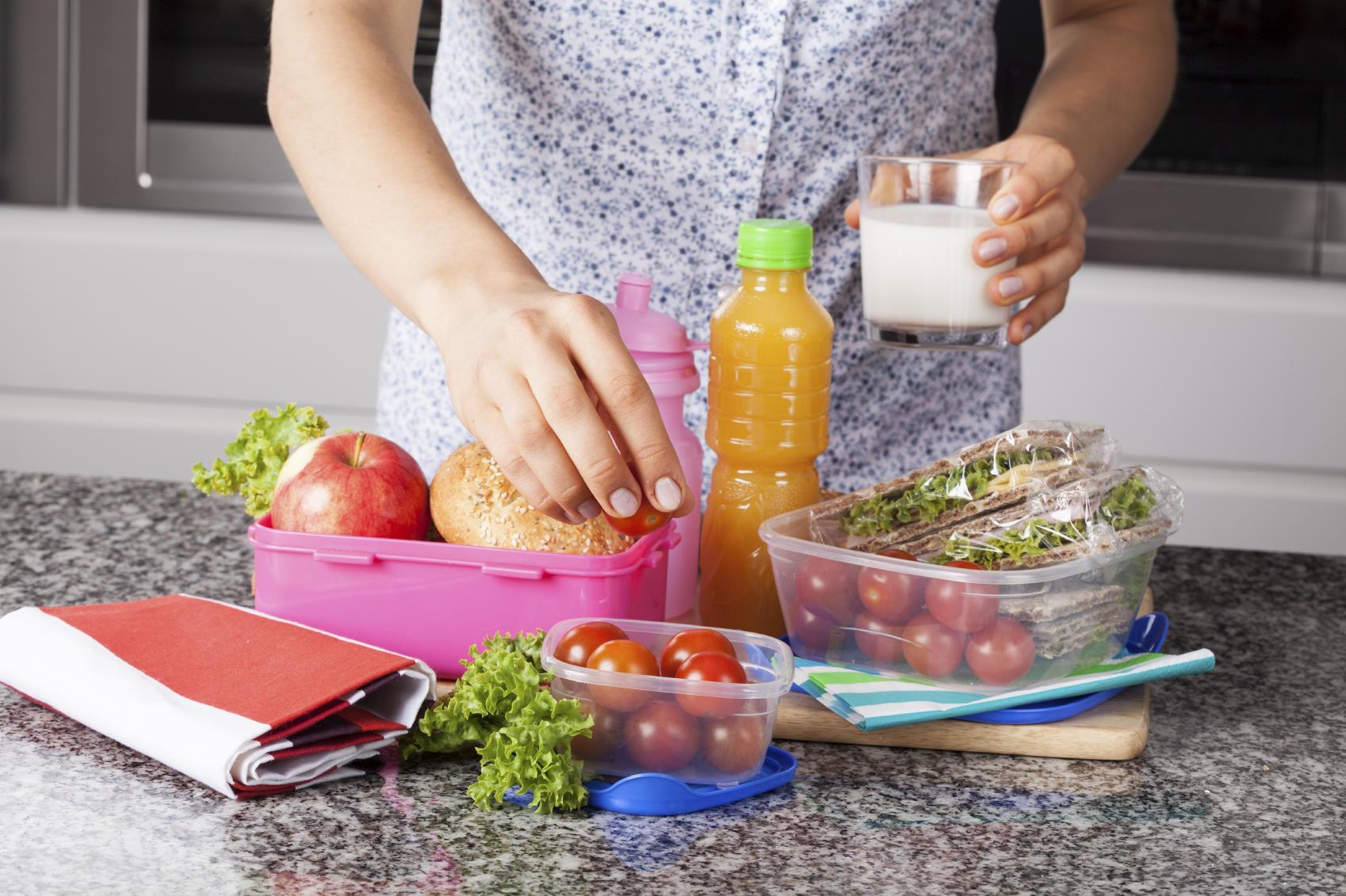 Mother preparing lunch box