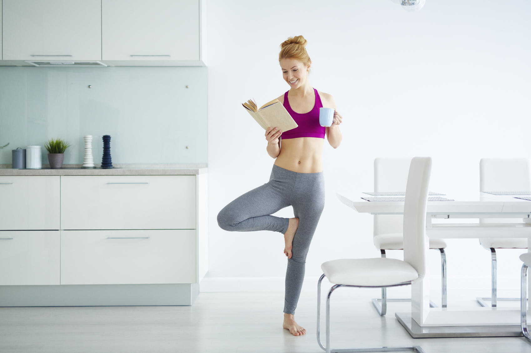 picture of girl reading and doing yoga