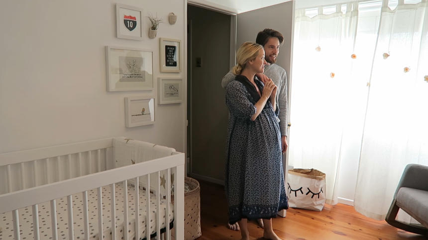 picture of new parents in baby nursery