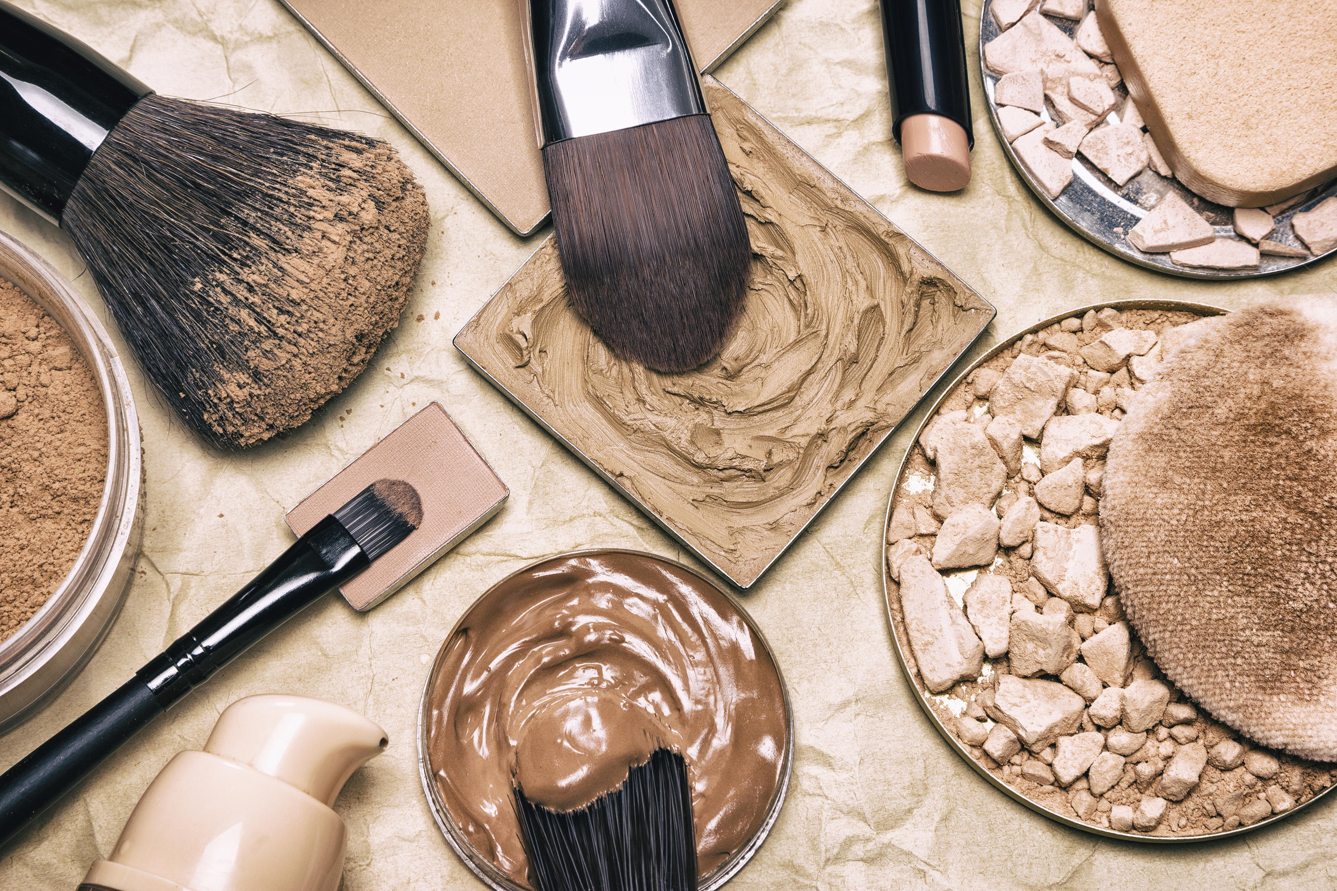 Makeup brushes, concealer and foundation
