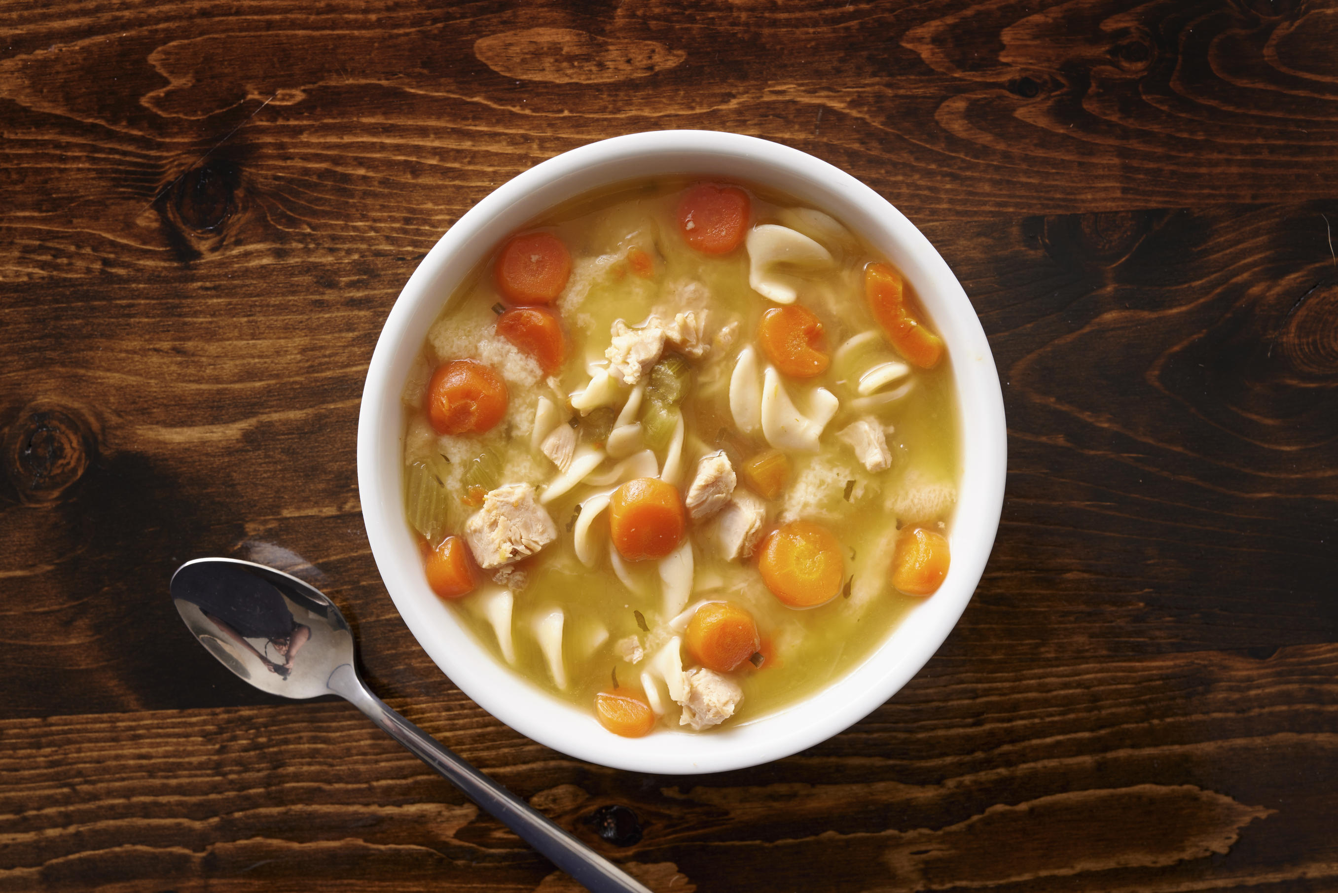 Chicken noodle soup on a wooden table