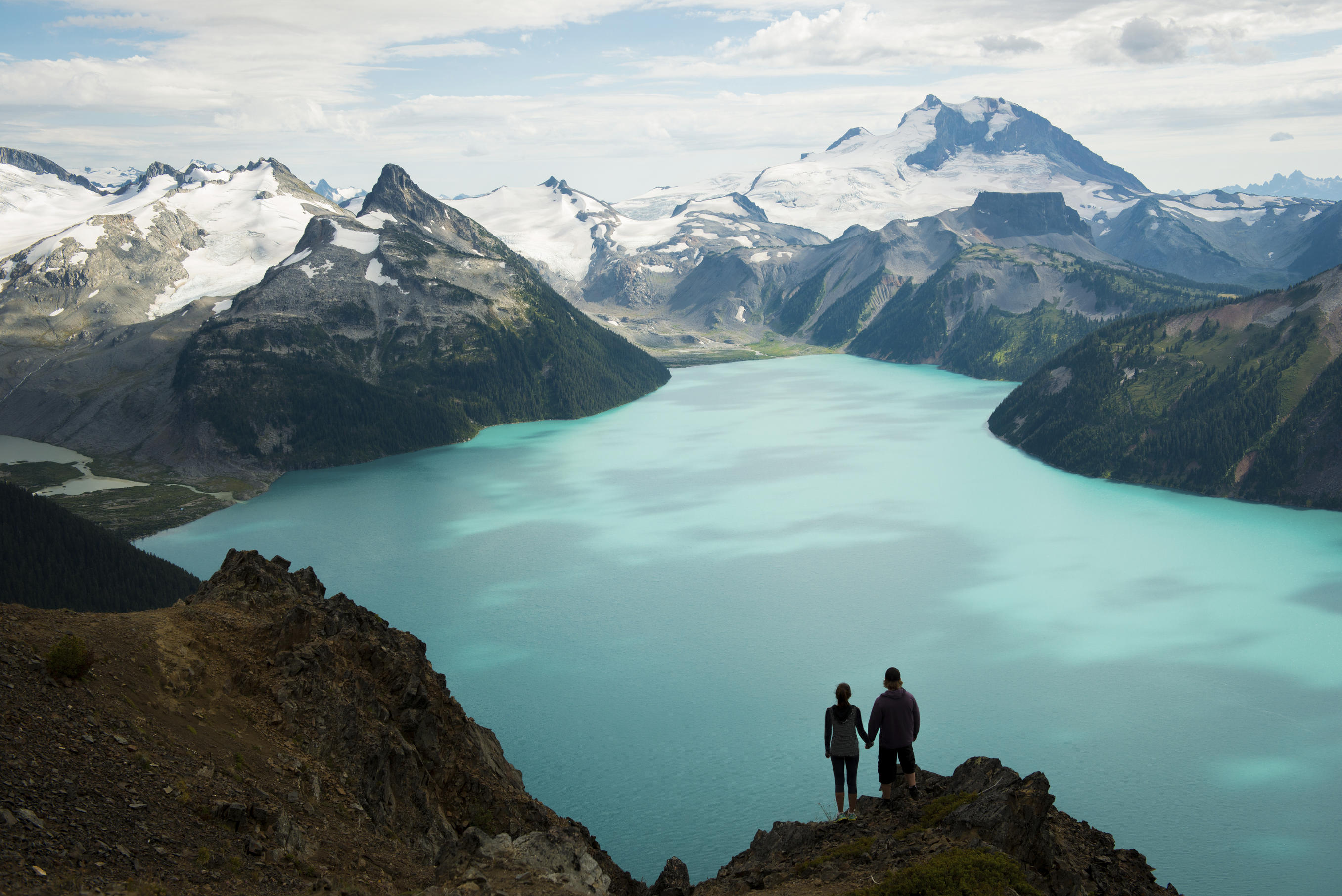 Couple looking over a stunning glacial view in British Columbia, Canada