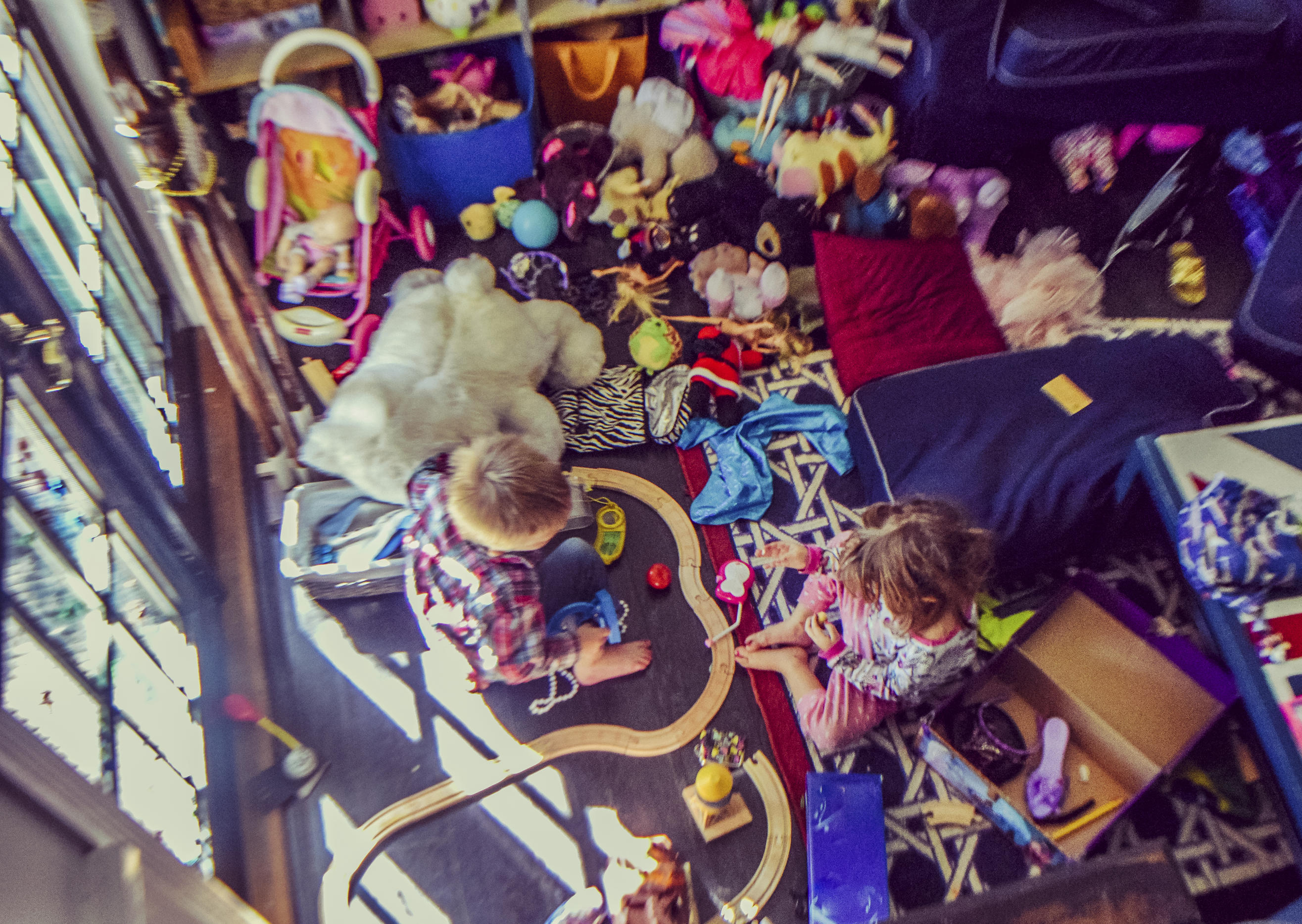 kids playing in a toy filled playroom