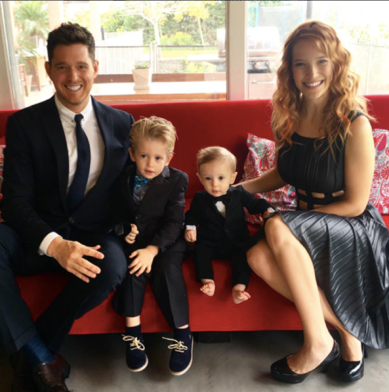 Michael Buble and family on a red couch