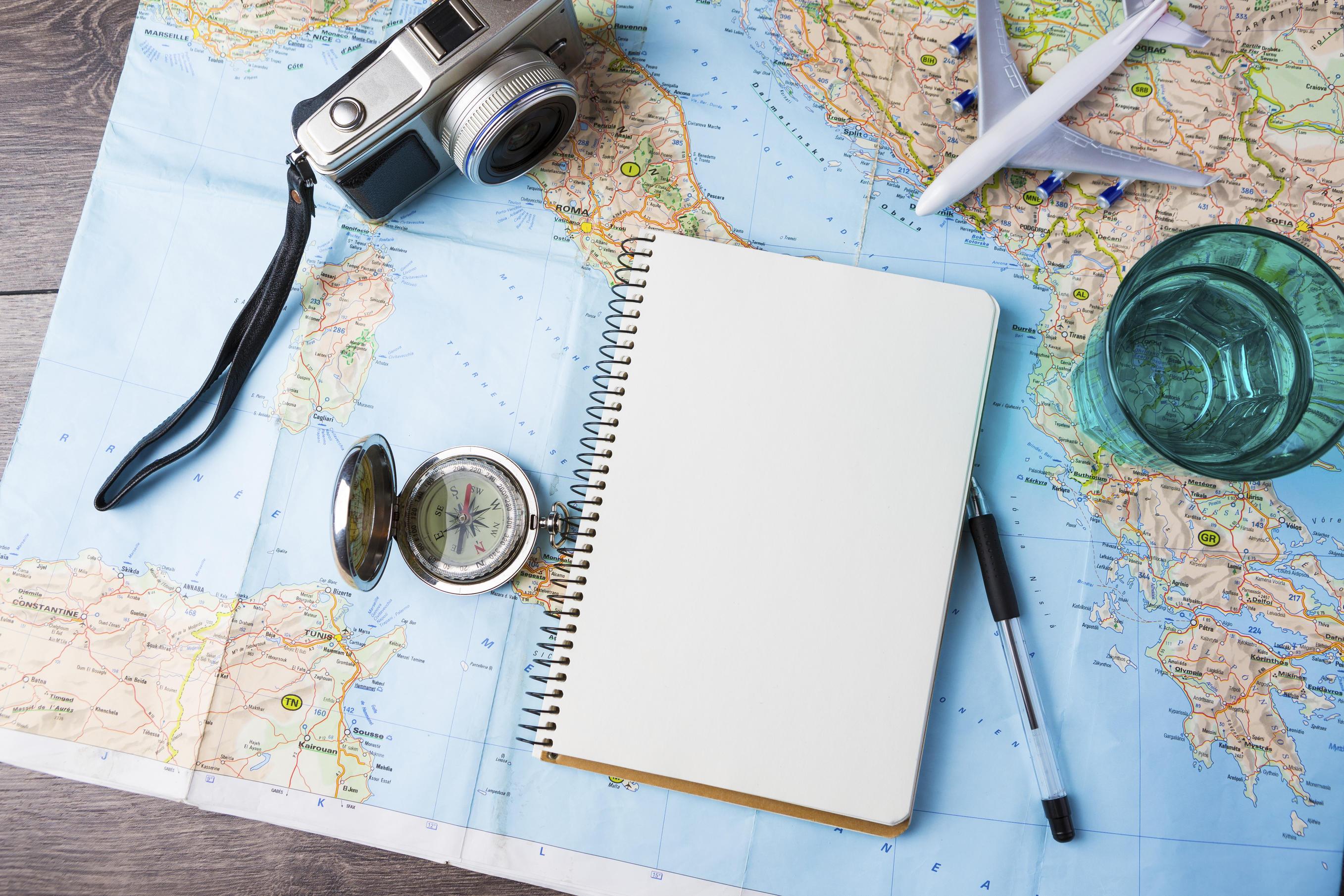maps, camera, notebook