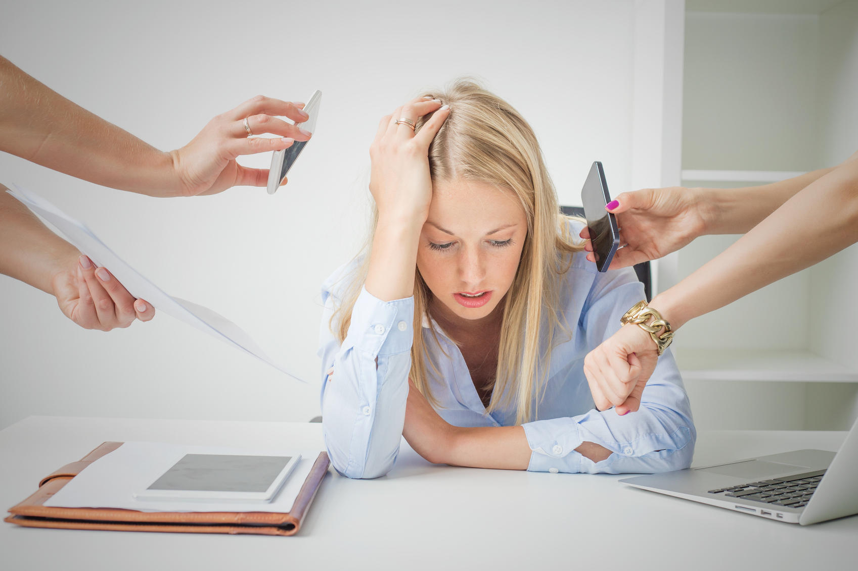 Woman work issues: woman overloaded with stuff at work
