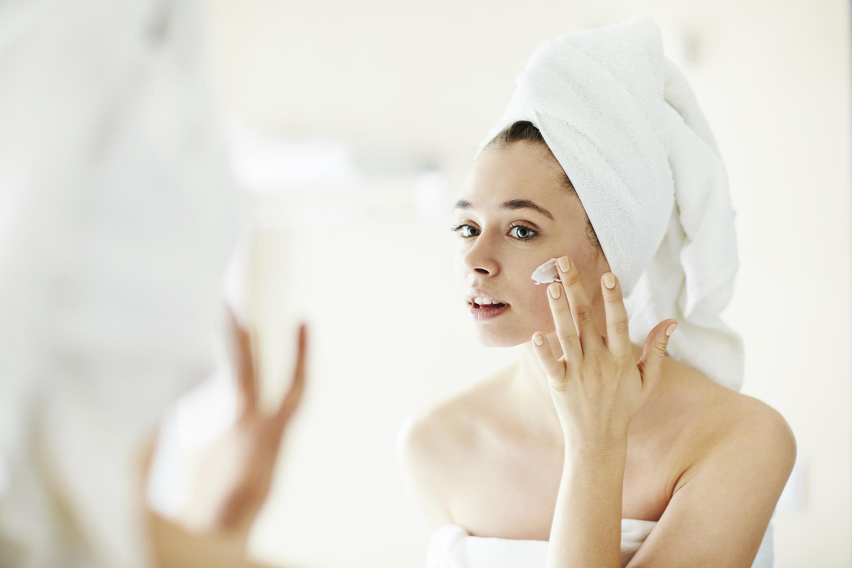 Woman applying pampering cream