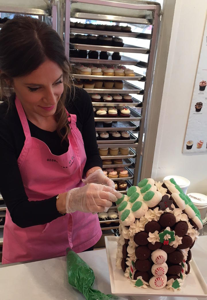 Katherine decorating a gingerbread cupcake house