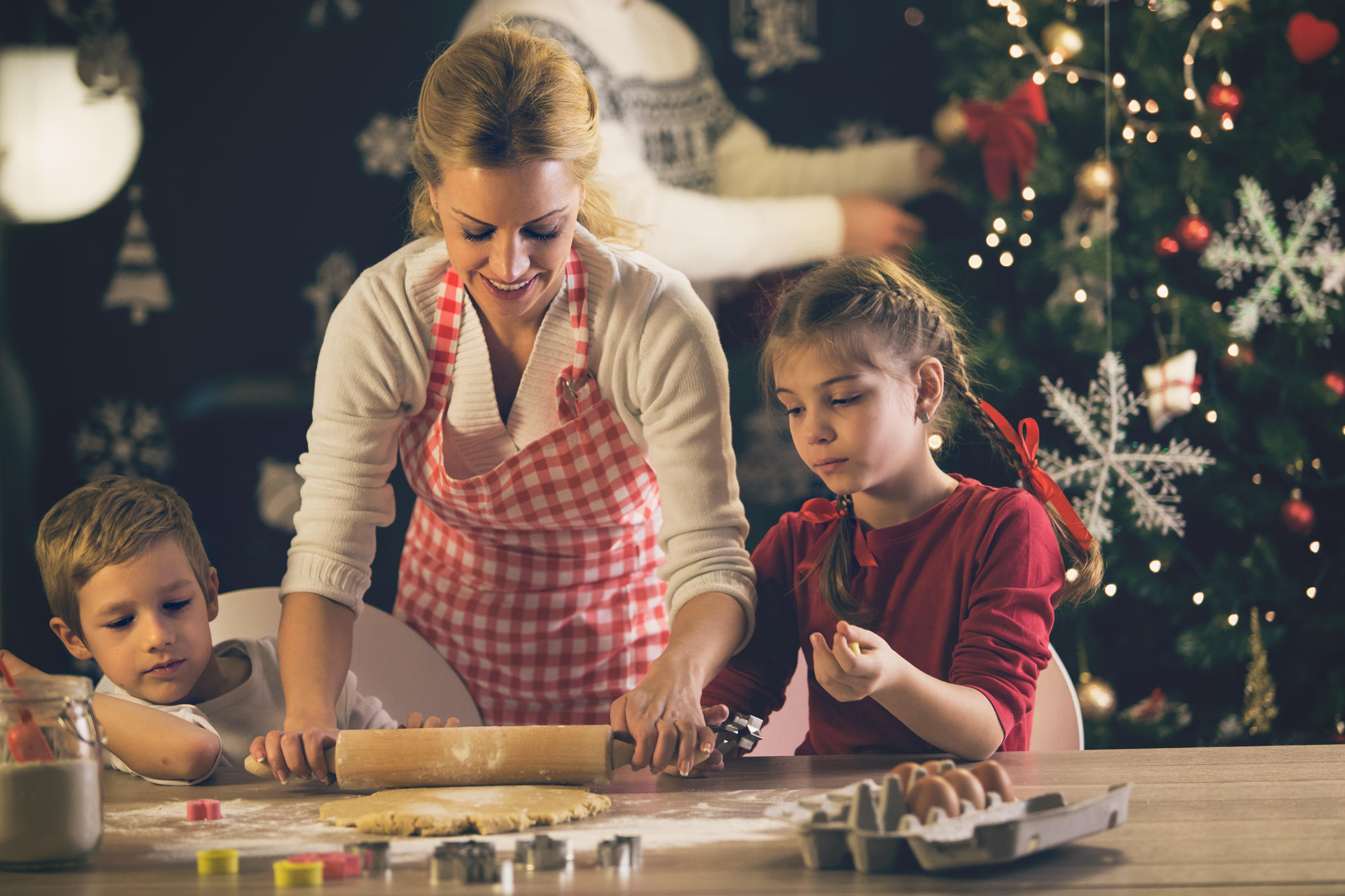 Mother, daughter and son baking cookies