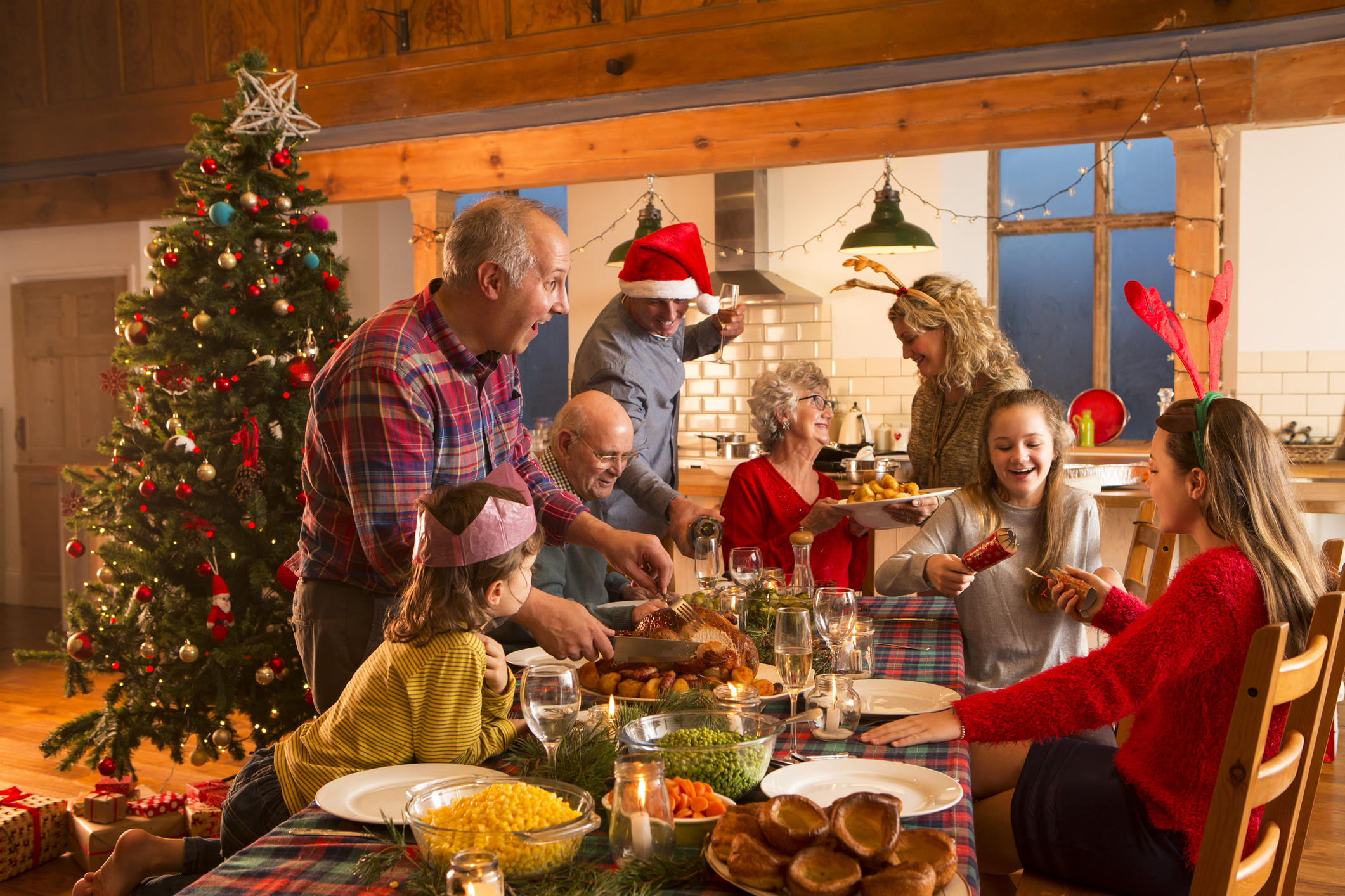 Family gathering around the table at Christmas time