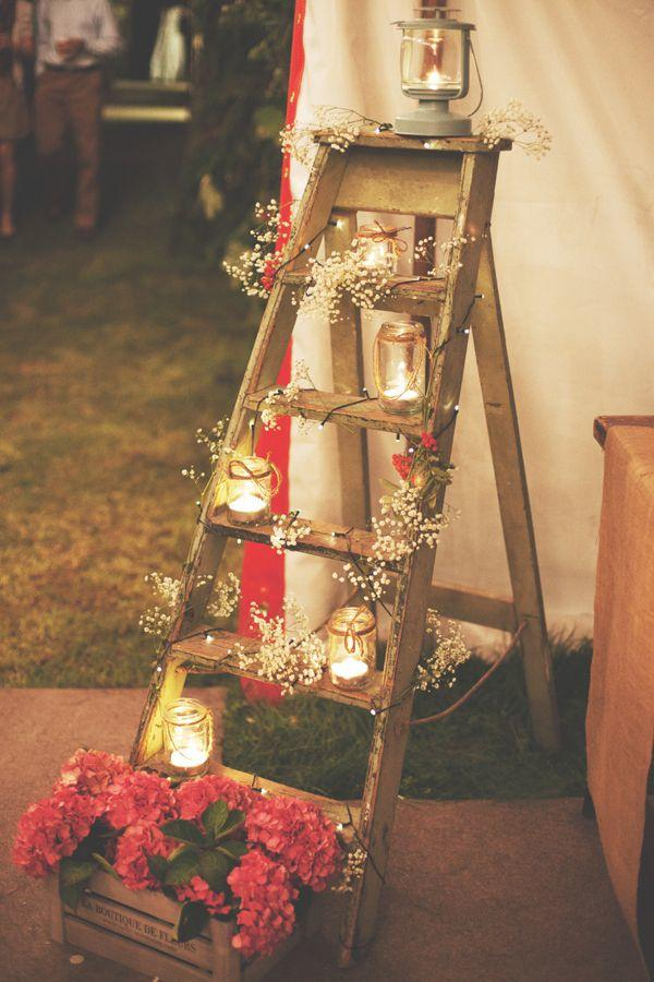 Your candle displays don't have to be big. Take this rustic ladder that's covered in small votives and baby's breath. It's a simple piece that when small candles are added, creates one of a kind wedding décor.
