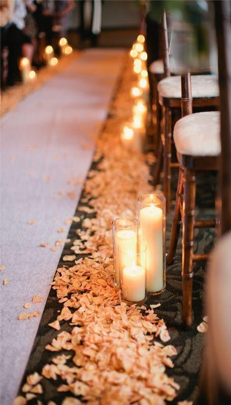 A simple aisle is transformed into a breathtaking scene when layers of pedals are topped with pillar candles. Imagine the fabulous pictures your photographer will capture as you walk down this candlelight aisle.