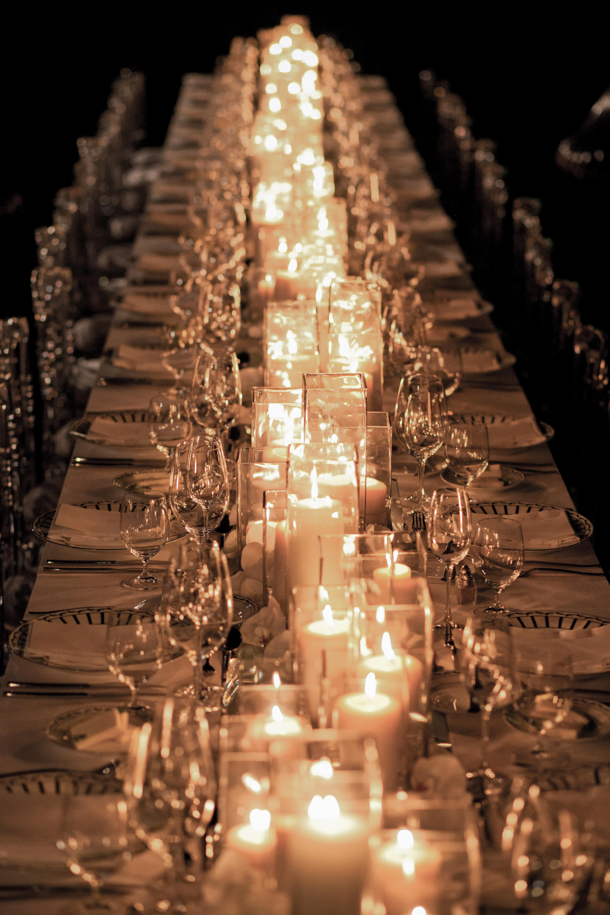 The candles will create a beautiful ambiance throughout your reception and you'll end up cutting your flower budget dramatically without sacrificing the look of your table décor.