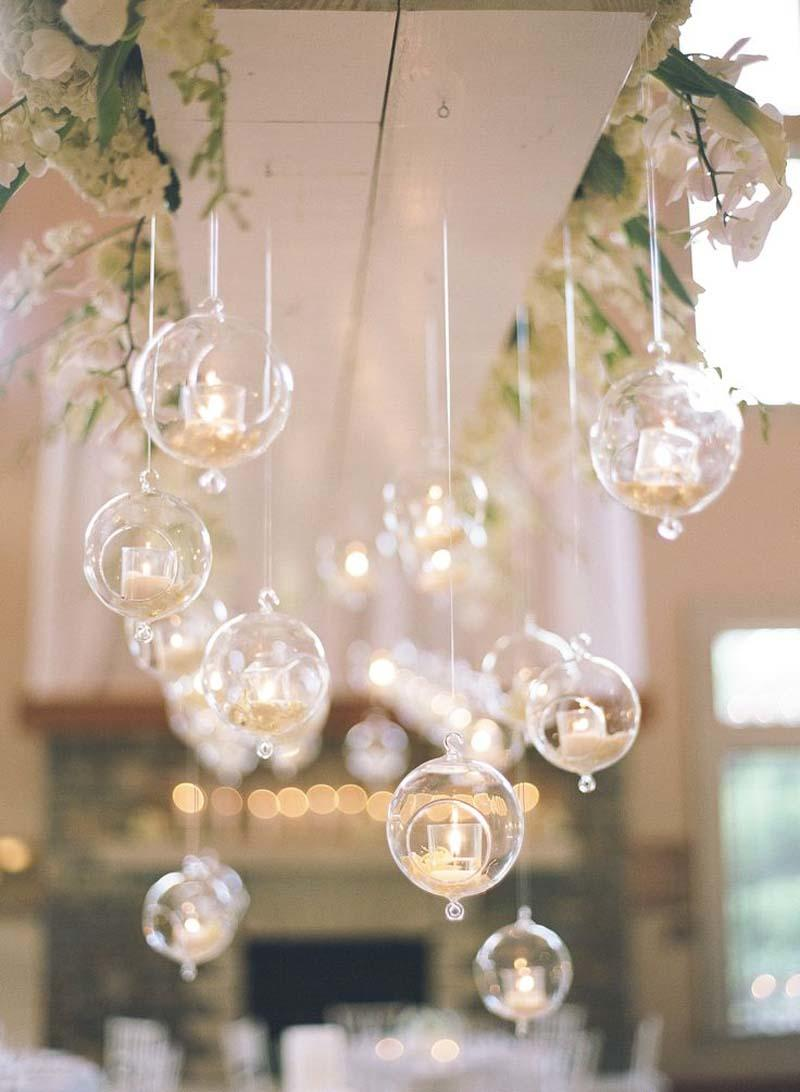 If you need to add more light to your space, don't look for a light switch! Find ways to pull candlelight from all angles, like these hanging votives. Simple and beautiful.